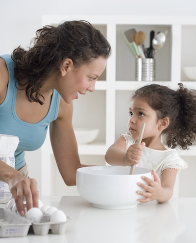 Girl cooking with mom, NextBillion Health Care
