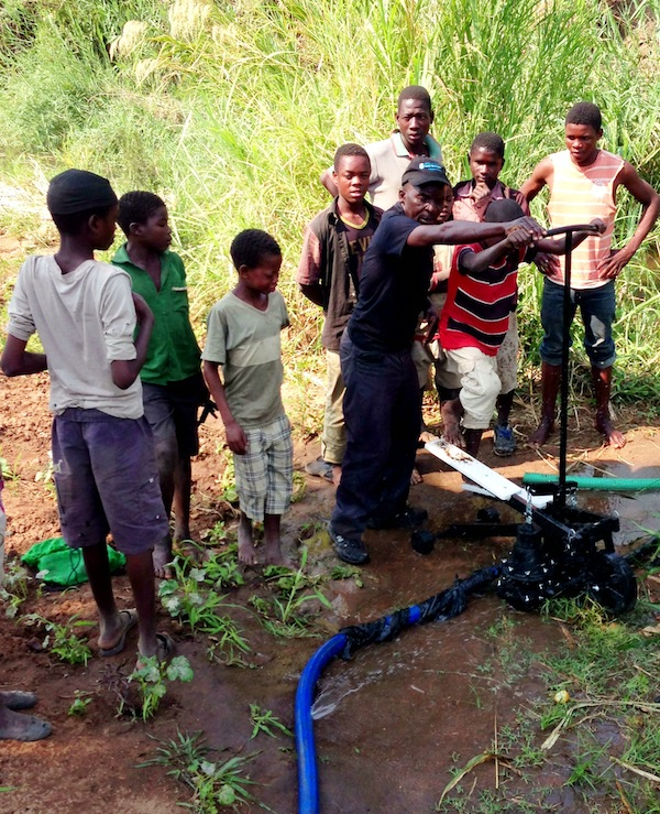 Malawi children are shown a demonstration of the Xylem's Saajhi Pump. (Image credit: Xylem)