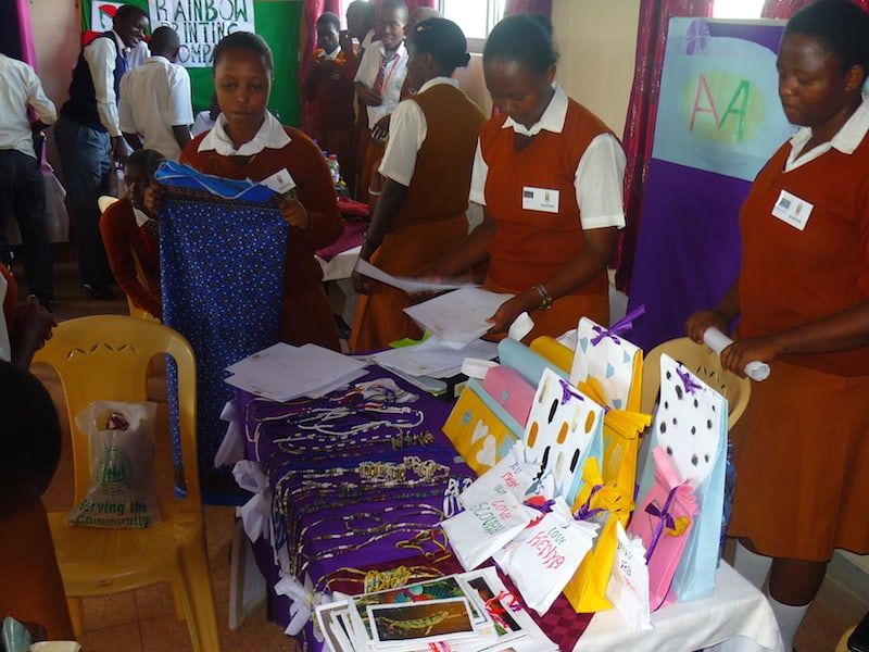Girls from Marvelous Arts at Kajire High Image: School setting up their stall