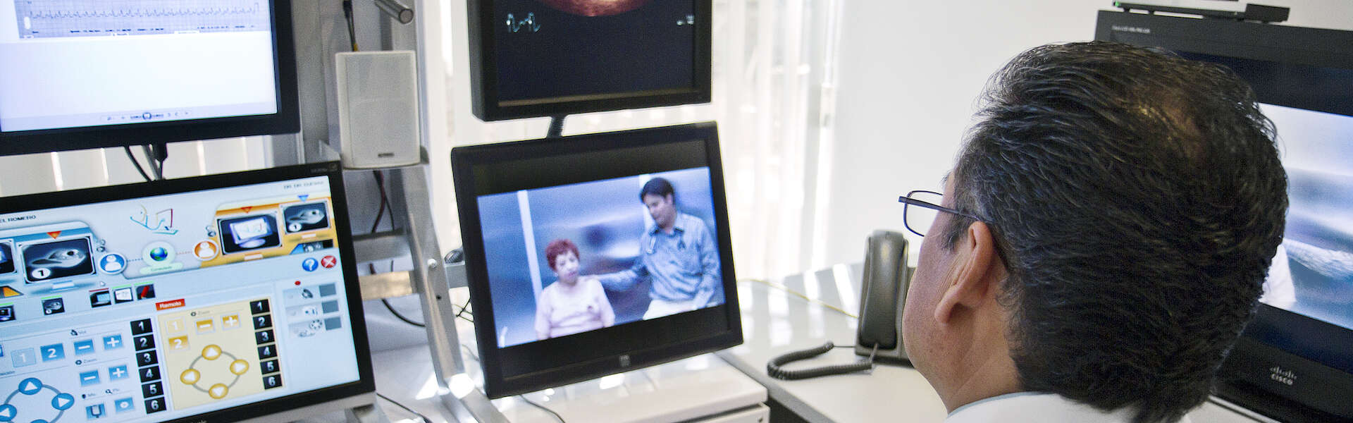 A cardiologist in Mexico has a pre-op consultation via video with a patient and her doctor who are 400 miles away in California.