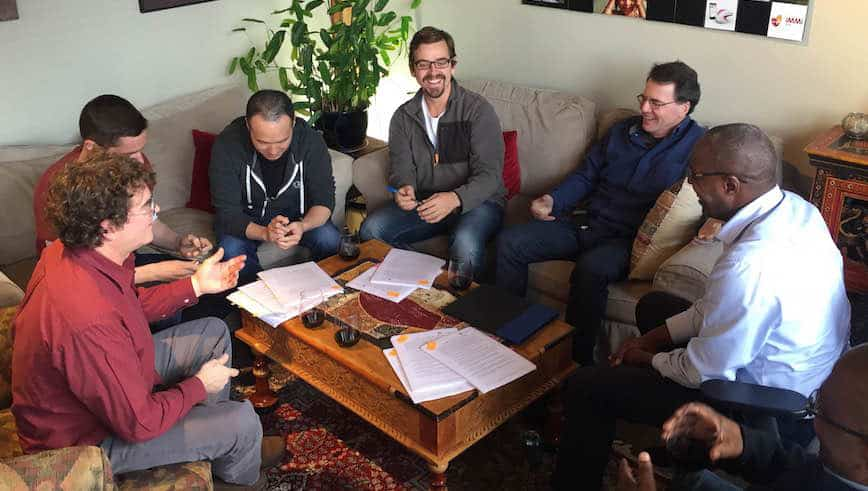 Capria Co-founder Will Poole (far left) in discussion with the first cohort of the Capria Accelerator.