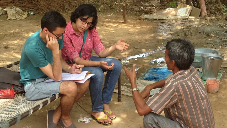 Eshita Dayani and Jonars Spielberg from MIT's Comprehensive Initiative on Technology Evaluation interview a local resident about his water quality and water filter usage in Ahmedabad, India.
