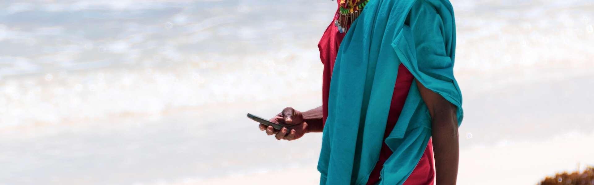 mobile digital phone beach africa man