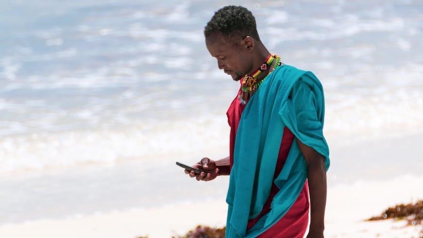 man beach africa kenya smartphone digital phone mobile
